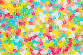 Colorful background from plastic beads. — Stock Photo