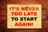 It's never too late to start again! written on a grunge paper — Stockfoto