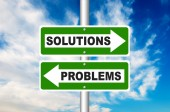 Solutions and Problems two way street road sign with a blue sky in a background — Stock Photo