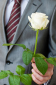 Man With A White Rose — Stock Photo