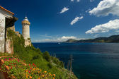 The lighthouse on the harbour — Stock Photo