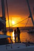 Couple in love on sailboat at sunset — Stock Photo