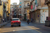 HAVANA - FEBRUARY 26: Classic car and antique buildings on Febru — Stock Photo