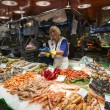 BARCELONA, SPAIN - JUNE 23, 2015: People buying food inside Mercat de Sant Josep de la Boqueria. It is a large public market in the Ciutat Vella district of Barcelona. — Stock Photo #78342946