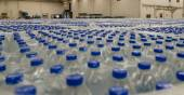 Thousands of water bottles are stored in warehouse — Stock Photo