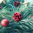 Christmas twig decorated with toys — Stock Photo #58312743