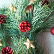 Christmas twig decorated with toys — Stock Photo #58312747