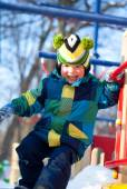 Boy on the playground in winter — Stock Photo