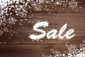 Winter sale background on wooden surface — Stock Photo