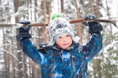 Boy in the snow outdoors — Stock Photo