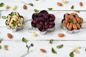 Almonds, cashews,  wild rose in a cookie cutters — Stock Photo