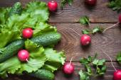 Lettuce, cucumbers  and radishes — Stock Photo