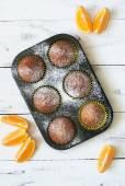 Orange muffins in baking dish — Stock Photo