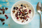 Oatmeal with dried fruit. — Stock Photo
