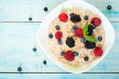 Oatmeal with different berries — Stock Photo