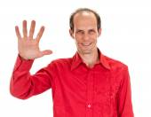 Portrait of happy smiling man showing five fingers — Stock Photo