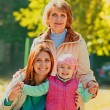 Grandmother with adult daughter and grandchild — Stock Photo #57836617