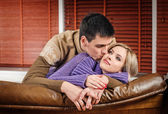 Young couple in the sofa — Stock Photo