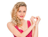 Girl showing heart symbol — Stock Photo