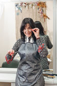Working Woman in hairdressing salon — Stock Photo