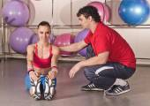 Fitness club woman with trainer — Stock Photo