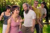 Yoga group doing dance — Stock Photo