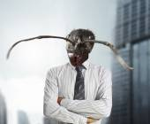 Businessman with a ant's head — Stock Photo