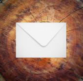 Envelope on wood — Stock Photo