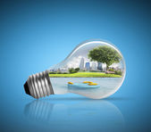 Electric light bulb and  green energy  — Stock Photo