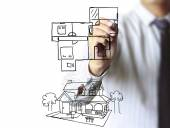 Hand drawing house in a whiteboard — Stock Photo