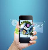 Hand holding smart phone — Stock Photo