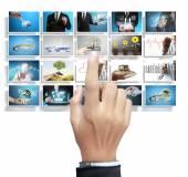 Businessman choosing digital photos — Stock Photo