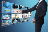 Man pushing on a touch screen digital photos — Stock Photo