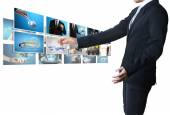 Man pushing on a touch screen digital photos — Stockfoto