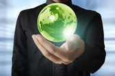 Holding a glowing earth globe in his hands. Earth image provided — Stock Photo