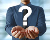 Man holding question mark — Stock Photo