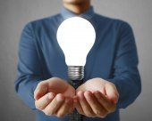 Man holding light bulb — Stock Photo