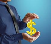 Businessman with financial symbols — Stock Photo