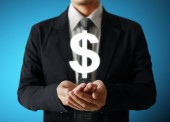 Businessman with a money icon — Stock Photo