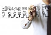 Business man drawing social network structure — Stock Photo