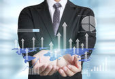Businessman with financial symbols coming  — Stock Photo