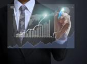 Businessman drawing graphics  — Stock Photo