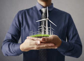 Wind turbines in the hand  — Stock Photo