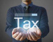 Businessman tax in  hand — Stock Photo