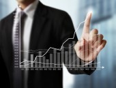 Financial symbols coming from han — Stock Photo