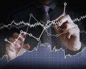 Drawing graphics a growing graph — Stock Photo