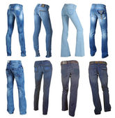 Collection of blue jeans isolated on white — Stock Photo