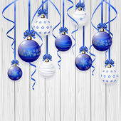 Blue Christmas balls on wooden background — Stock Vector