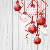 Červené vánoční koule na dřevěné pozadí — Stock vektor