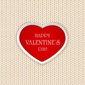 Red heart on knitted pattern — Stockvektor